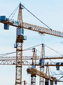 at a construction site more building cranes are in use. boom in construction