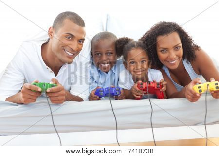 poster of Animated Family Playing Video Game Lying Down On Bed
