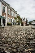 stock photo of edwardian  - Row of Edwardian houses on a cobbled street in Exeter Devon - JPG