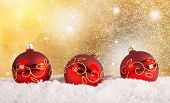 Chrsitmas red balls background with snow