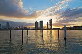 Downtown skyline at sunset with cloudy skies in Miami Florida.