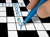 Crossword - time and money, hand with pen