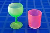 Stylish green and red glass on blue tablecloth