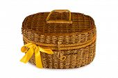 Basket with yellow bow, isolated on white, clipping path