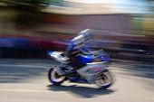 Biker With A Motorcycle In Motion Blur