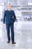 Young Man In Aircraft Service Uniform In Airport Area