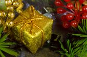 Gold gift, close-up, christmas background