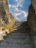 Old stone staircase to sky, cloudscape