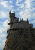 Old castle on cliff, cloudy sky