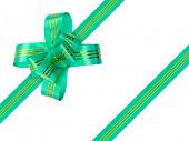 Green bow and ribbon isolated on white background