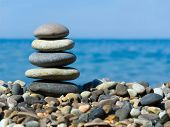 Stack of stones on beach, sea and sky