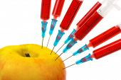 Apple and syringes isolated on white background