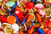 Heap of multicolored pins, abstract stationery background