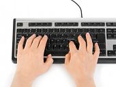 Computer keyboard and hands isolated on white background