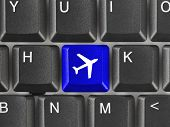 Computer keyboard with Plane key - technology background