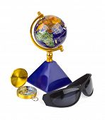 Sunglasses, compass and globe - travel concept