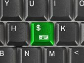 Computer keyboard with money key - business background