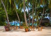 Cafe on the beach of tropical island - vacation background