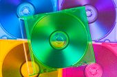 Computer disks in multicolored boxes - technology background
