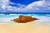 Stone on tropical beach at Seychelles - nature background