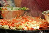 image of food truck  - Cooking vegetables an sausage at a food truck in Portland Oregon - JPG