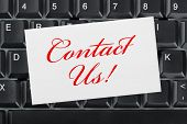 Computer keyboard and card Contact Us - business background
