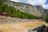 Ruins of stadium in Delphi, Greece - archaeology background