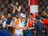 SEPANG, MALAYSIA - APRIL 10: Adrian Sutil (team Force India) at the autograph session on Formula 1 GP, April 10 2011, Sepang, Malaysia