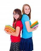 Happy Schoolgirls Holding Colorful Books
