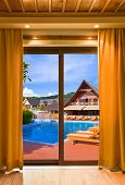 Hotel room and water pool - vacation concept background