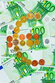 Euro coins and banknotes - abstract business background