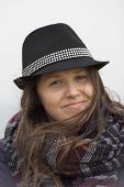 Smiling Girl With A Black Hat