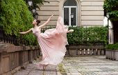 image of ballerina  - Young beautiful ballerina with pink dress dancing - JPG