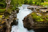 Waterfall near Geiranger fjord Norway - nature and travel background