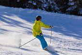 Skier at mountains ski resort Bad Gastein Austria - nature and sport background