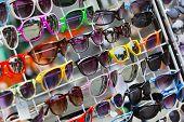 Stylish multicolored sunglasses - shopping background