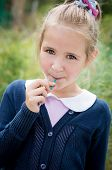 Portrait Of Sweet Girl With Lollipop