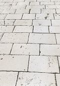Retro tiled floor on street at Croatia - architecture background