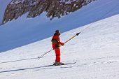 Skier at mountains ski resort Innsbruck Austria - nature and sport background