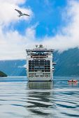 Cruise liner in Geiranger fjord Norway - nature and travel background