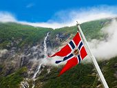 Norway flag and waterfall - nature and travel background