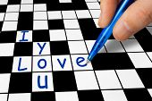 Hand filling in a crossword - I love you