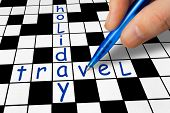 Hand filling in crossword - Holiday and Travel