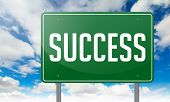 Success on Green Highway Signpost.