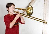 picture of trombone  - portrait of a boy playing the trombone - JPG