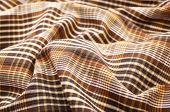 Brown crumpled plaid cloth