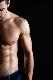 pic of bicep  - Portrait of beautiful and muscular man in dark background - JPG