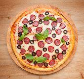 image of hot fresh pizza  - Tasty Fresh flavorful pepperoni pizza on wood - JPG