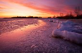 stock photo of fiery  - Winter landscape with sunset fiery sky - JPG