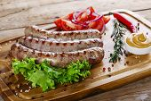 stock photo of grilled sausage  - grilled sausages on the grill on the board - JPG